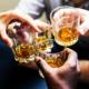 Hands clinging alcohol drink glasses